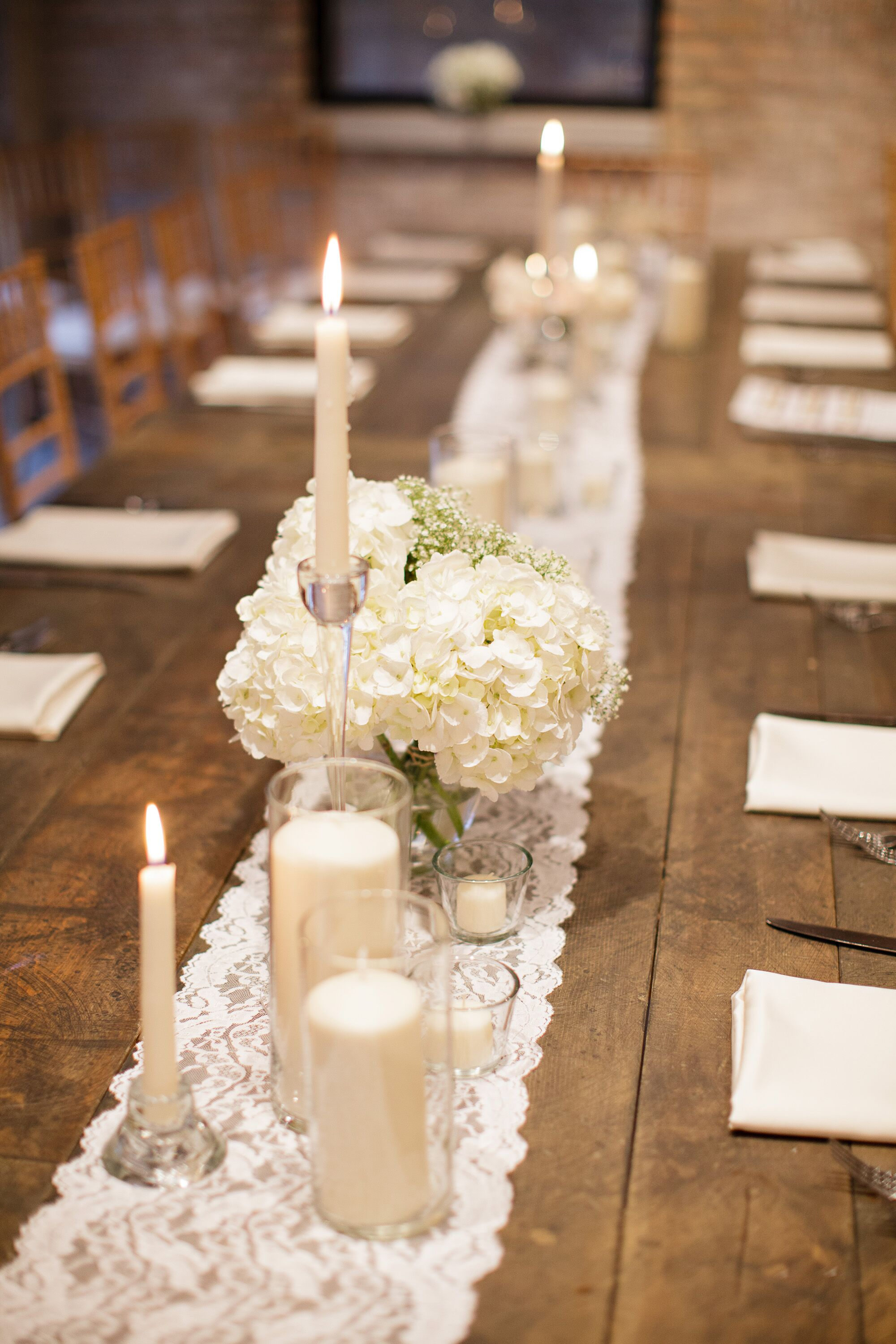 Lace farm table runner with candles and hydrangeas