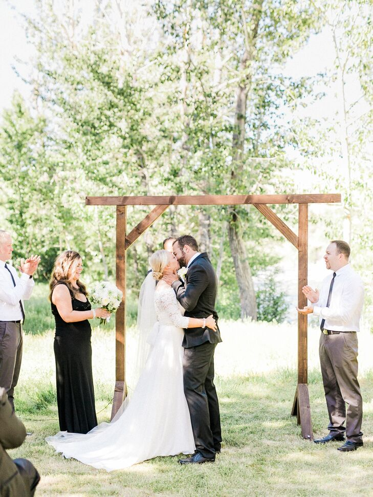Kassi and Mark exchanged vows on a private property set near the Truckee River in Verdi, Nevada, under a wooden arch that Mark had built.
