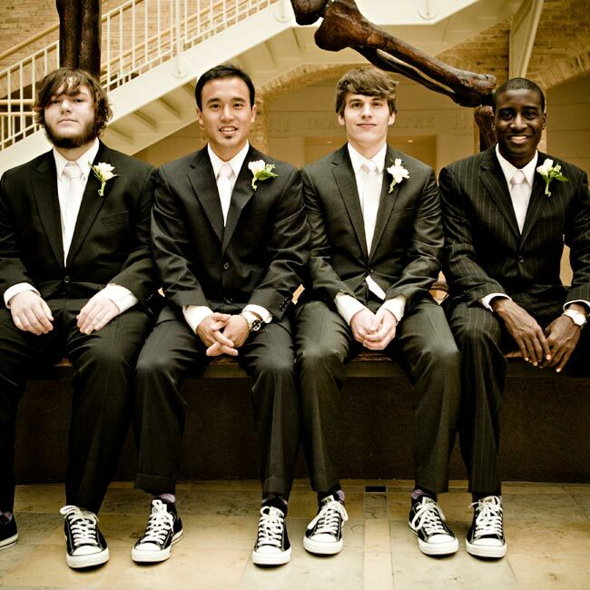 743bd700d2841b Black Converse Chuck Taylors and skinny pink ties dressed down the guys   traditional suits.