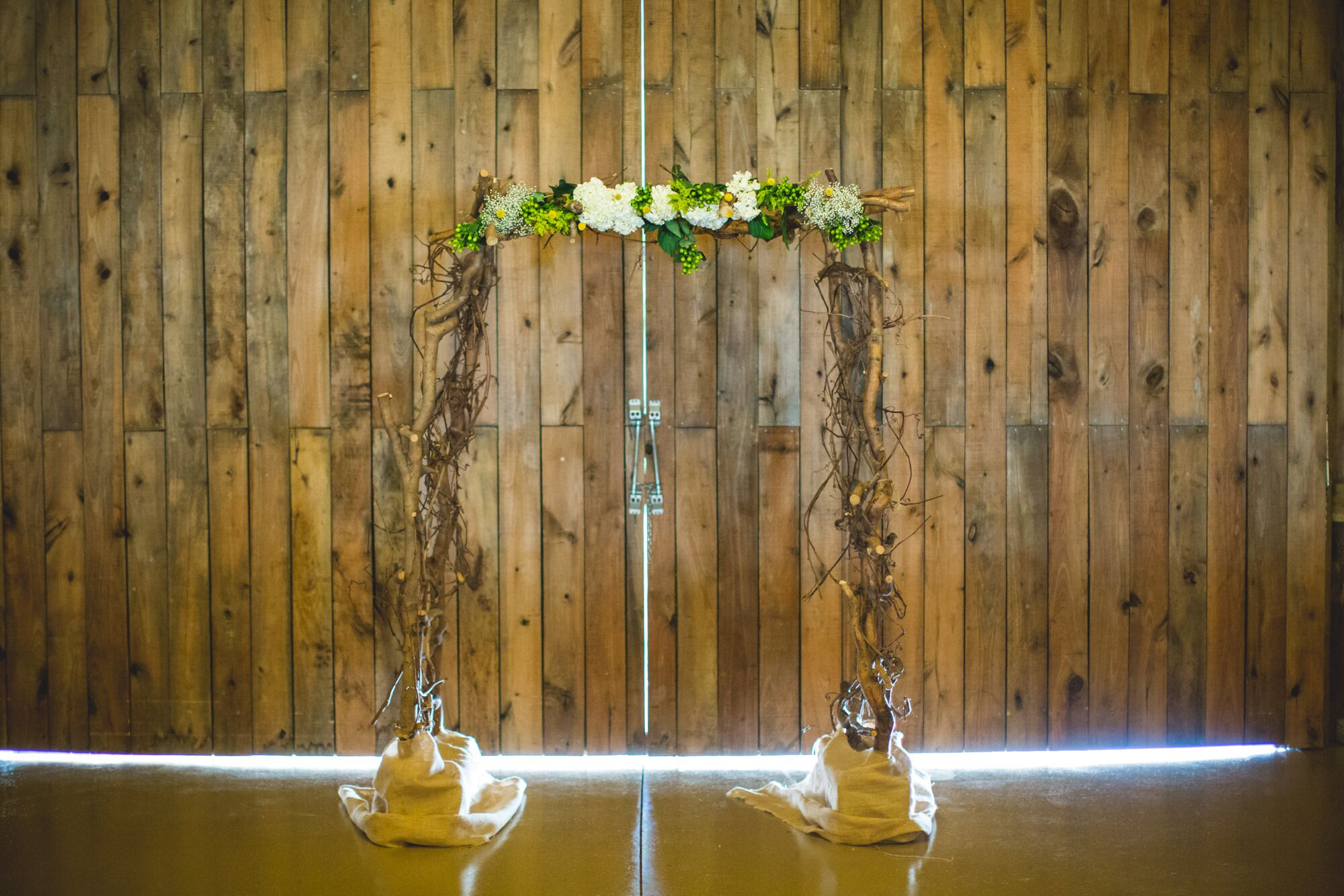 Branch Wedding Arch Topped With Flowers