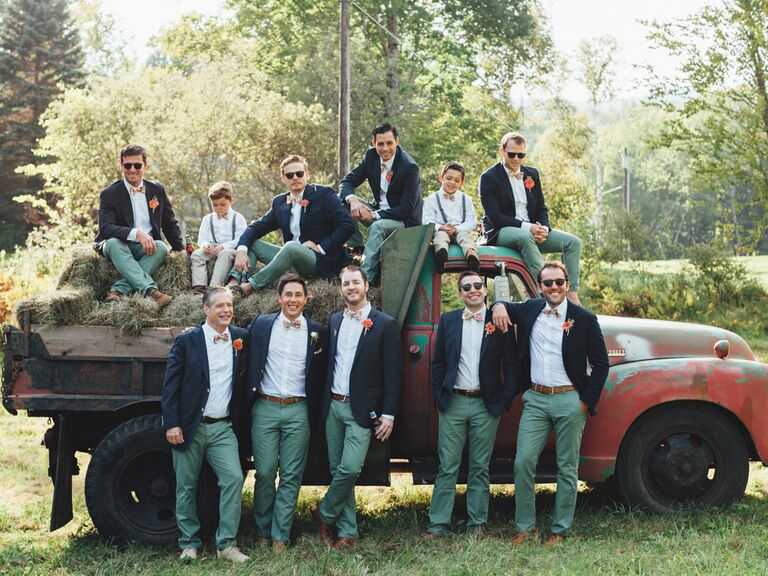 Groomsmen standing on a red truck