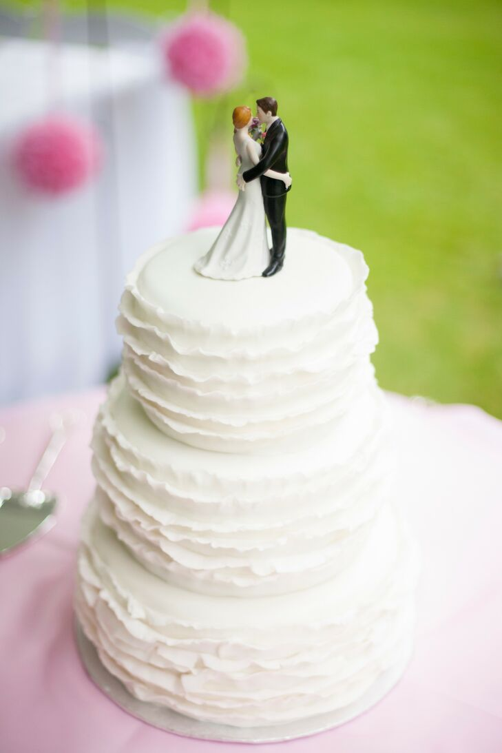 The three tier white cake had gorgeous ruffle layers giving the cake a romantic touch.