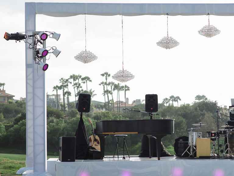 White performance stage with crystal chandeliers