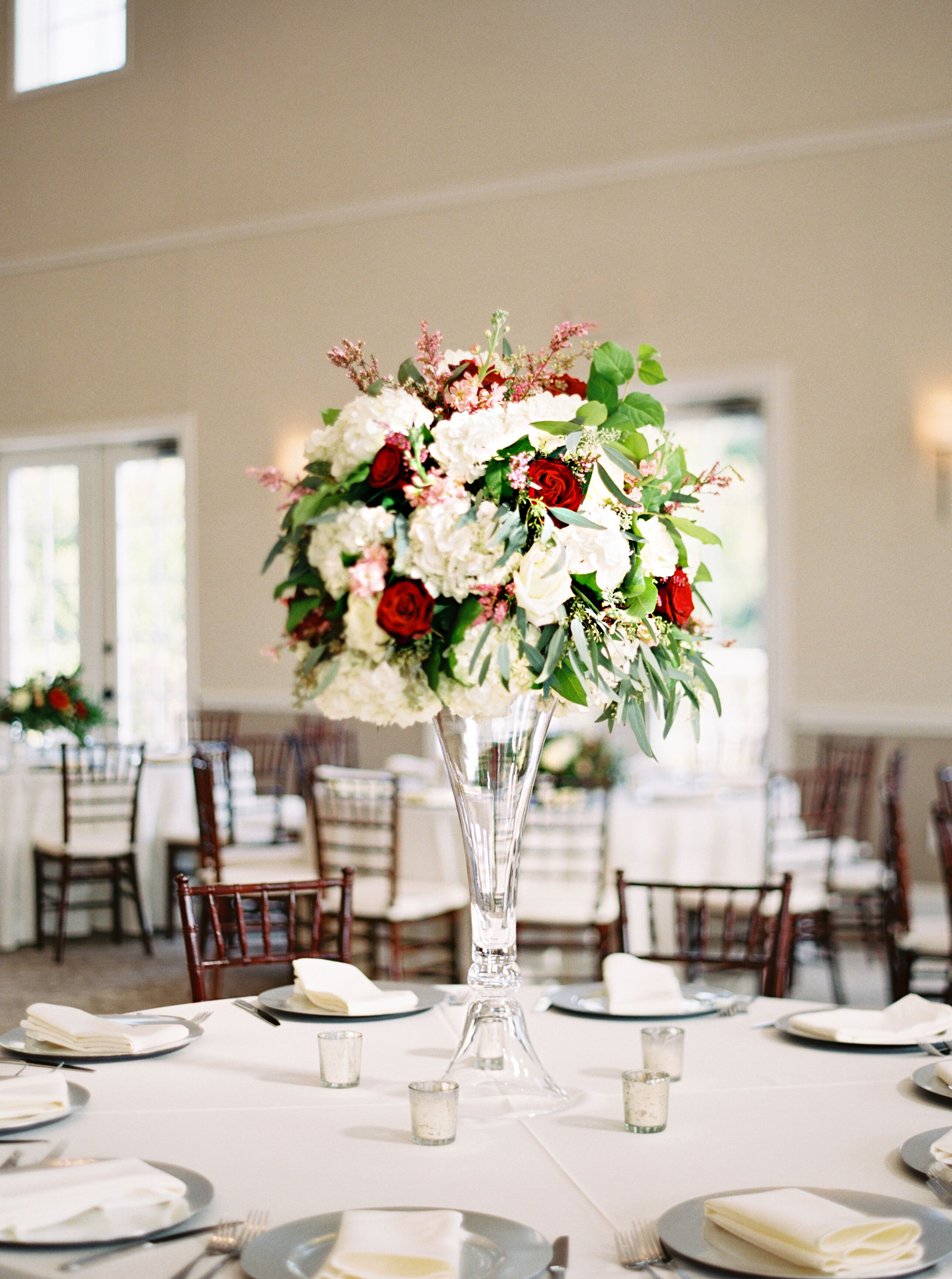 White blush and burgundy rose centerpiece