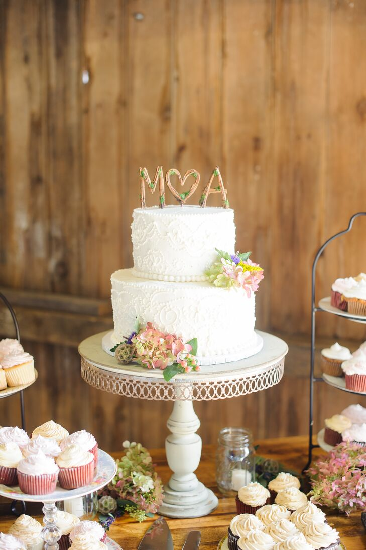 White Wedding Cake On Vintage Stand