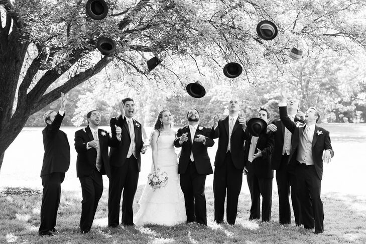 """My favorite part about the groomsmen's style was their hats,"" Alexandra says, ""which we gave to them as thank-you gifts."" Alexandra and Will bought each groomsman a black top hat from Goorin Brothers, adding a traditional, vintage touch to their formal black tuxedos."