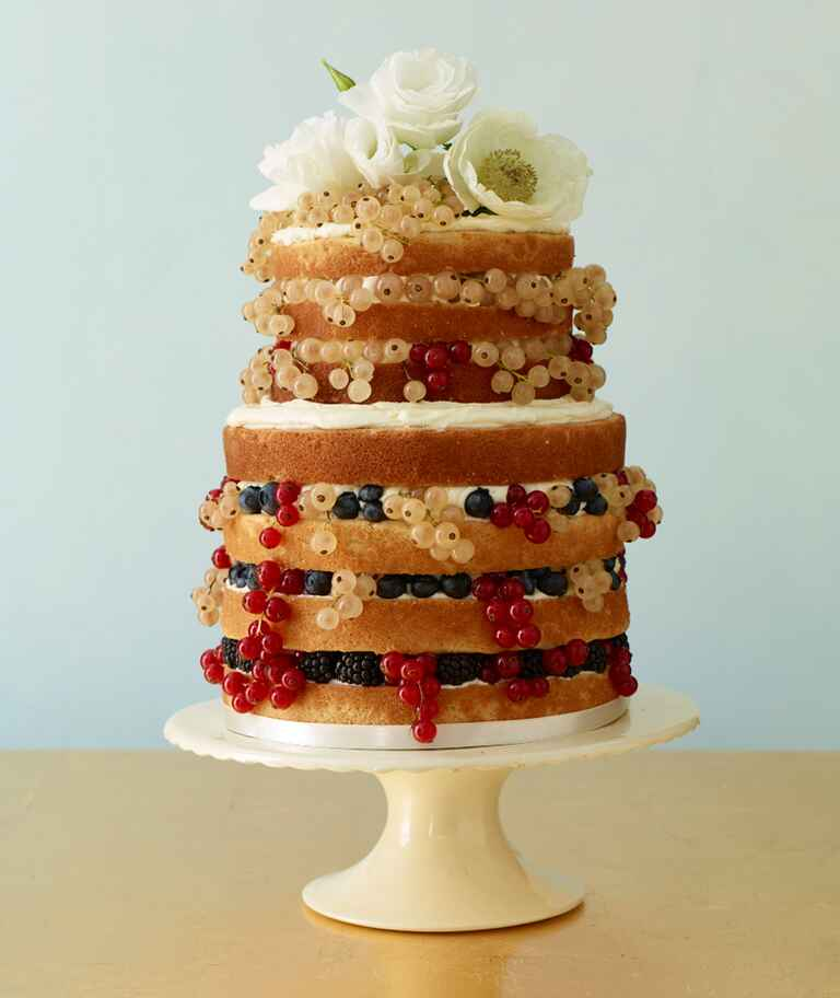 Simple naked cake with berries and flowers