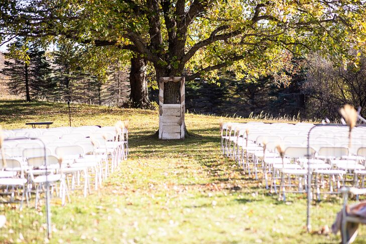 The ceremony was held outside underneath an oak tree at Five Lakes Resort. A vintage door served as the backdrop.