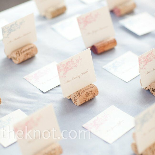 Each card was tucked into a stand made of three wine bottle corks glued together.
