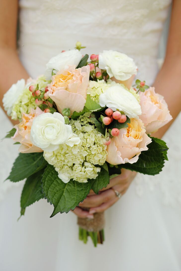 Kathleen incorporated green and white elements into her flowers and decor with soft hints of sweet country peach. Her bouquet included peach garden roses with white ranunculus, hydrangeas and hypericum berries.