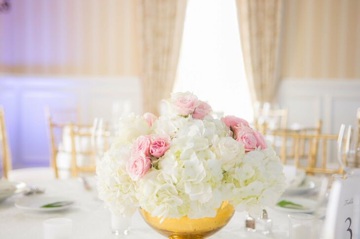 The centerpieces were simple, elegant arrangements of white hydrangeas and pink roses.