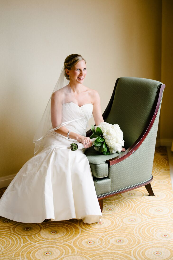 Inspired by the wedding's elegant, timeless theme, Meredith chose a Vera Wang gown in a strapless, trumpet silhouette. The dress featured draping along the bodice for an element of depth and texture.