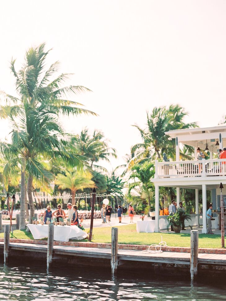 """Once we stepped foot on the Caribbean Resort, we knew it was our dream venue,"" Francesca says. ""The intimate, gorgeous houses and breathtaking grounds left us speechless and imagining the perfect wedding weekend."" Of course, their open-air reception took advantage of the venue's waterfront views and gorgeous palm trees. Each of the115 guests sat below lines of string lights and found their seats listed on pineapples by the water."