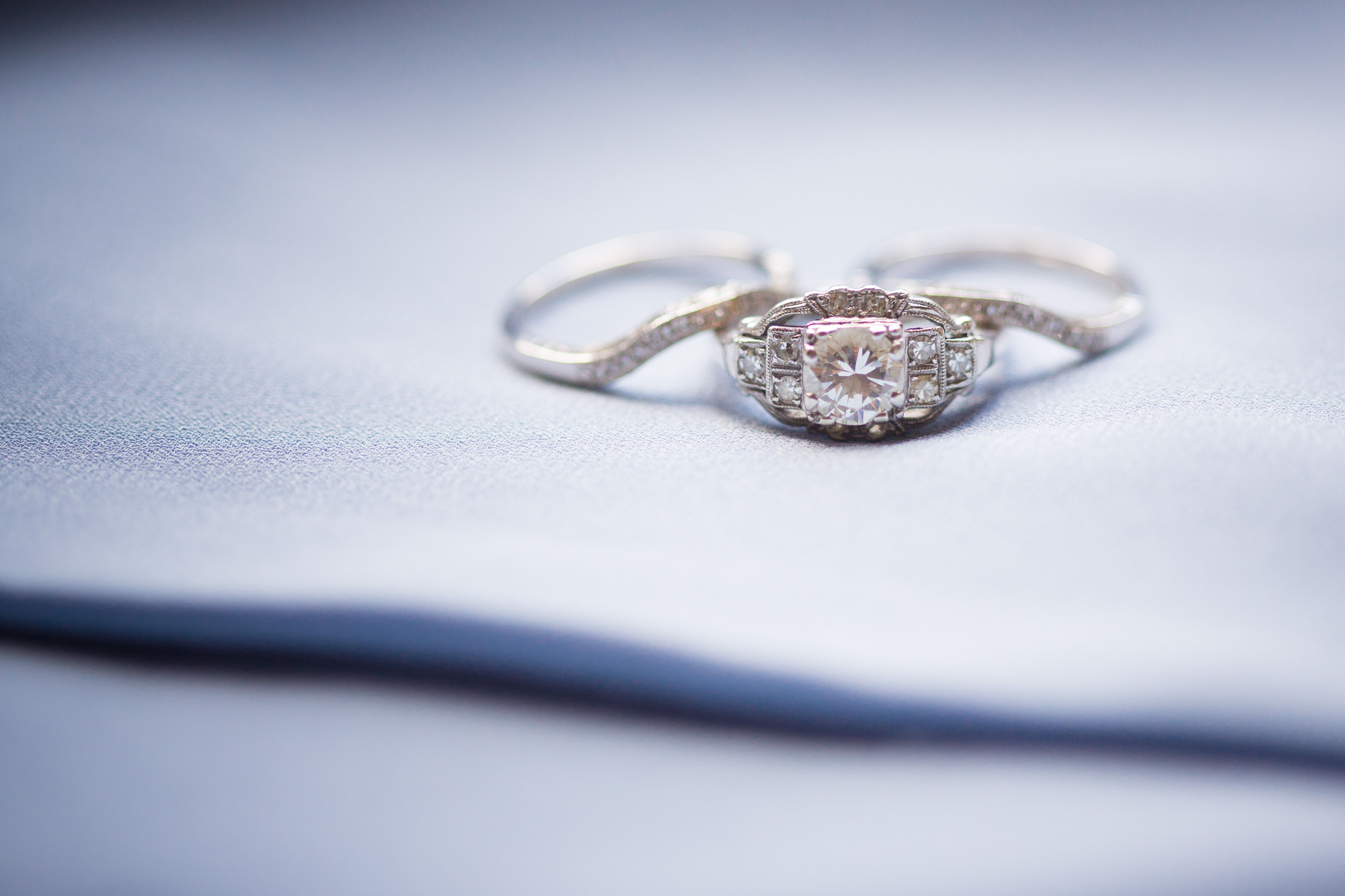 Ornate Round Cut Diamond Engagement Ring in Square Setting
