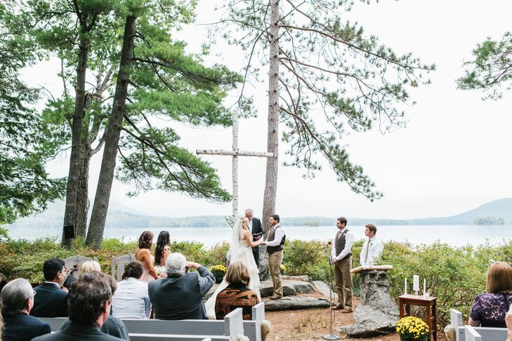 "Alissa and Greg had their ceremony on at Chocorua Island Chapel on Church Island, located in the middle of Squam Lake. ""It is a completely outdoor venue with pews that are nestled amongst the pine and birch trees,"" says Alissa. ""We decided to keep the decorations simple since the venue holds so much natural beauty itself."""