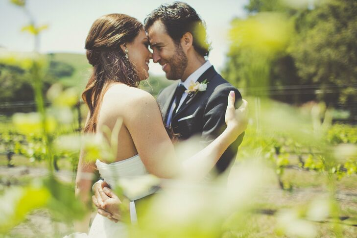 A romantic vineyard served as the perfect backdrop for Lindsey and Clay's elegant, rustic wedding. Between overflowing florals, antique furniture and