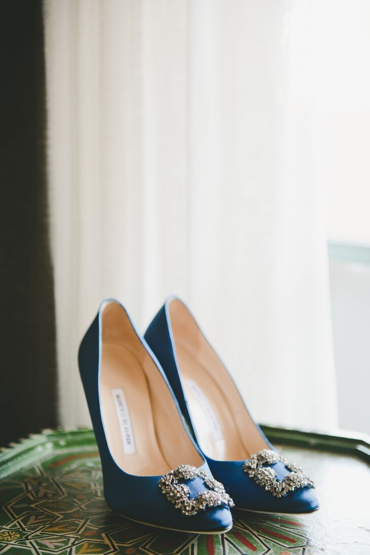 "As her ""something blue,"" Brittany wore these satin bejeweled Manolo Blahnik pumps."