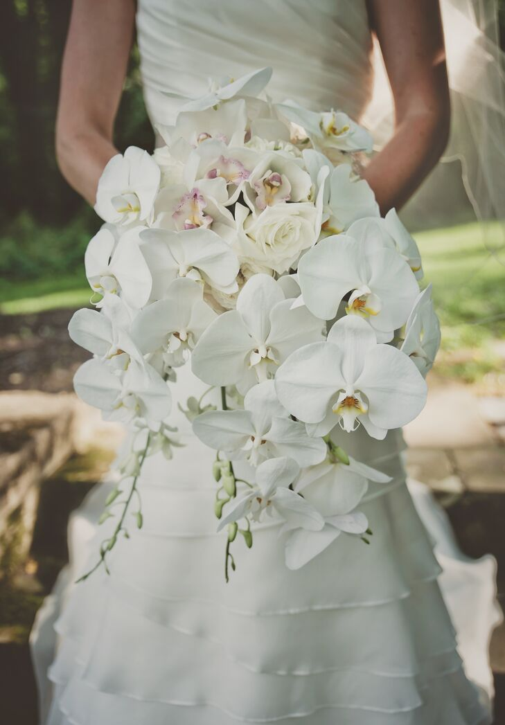 Blair's bridal bouquet was timeless and elegant made with white orchids and roses.