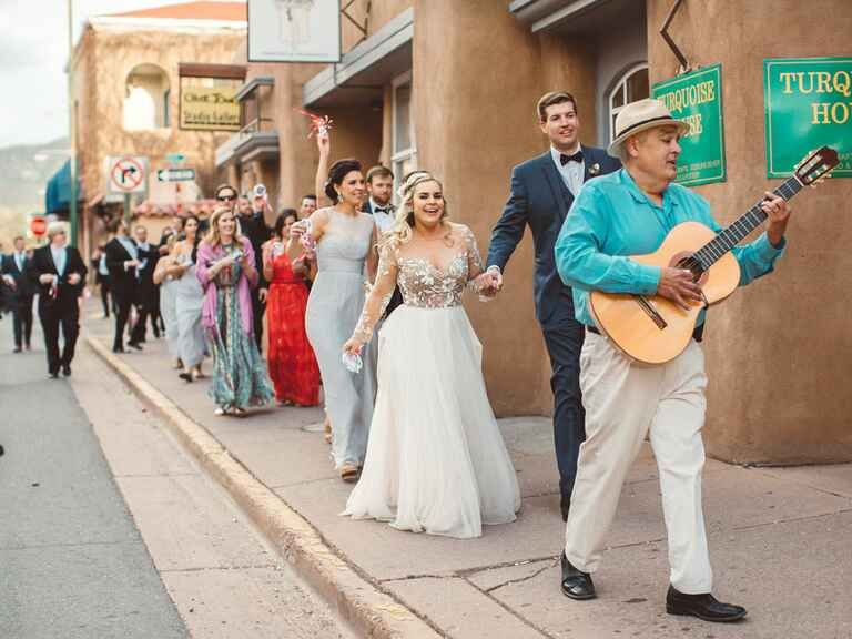 Wedding party walking through Santa Fe.