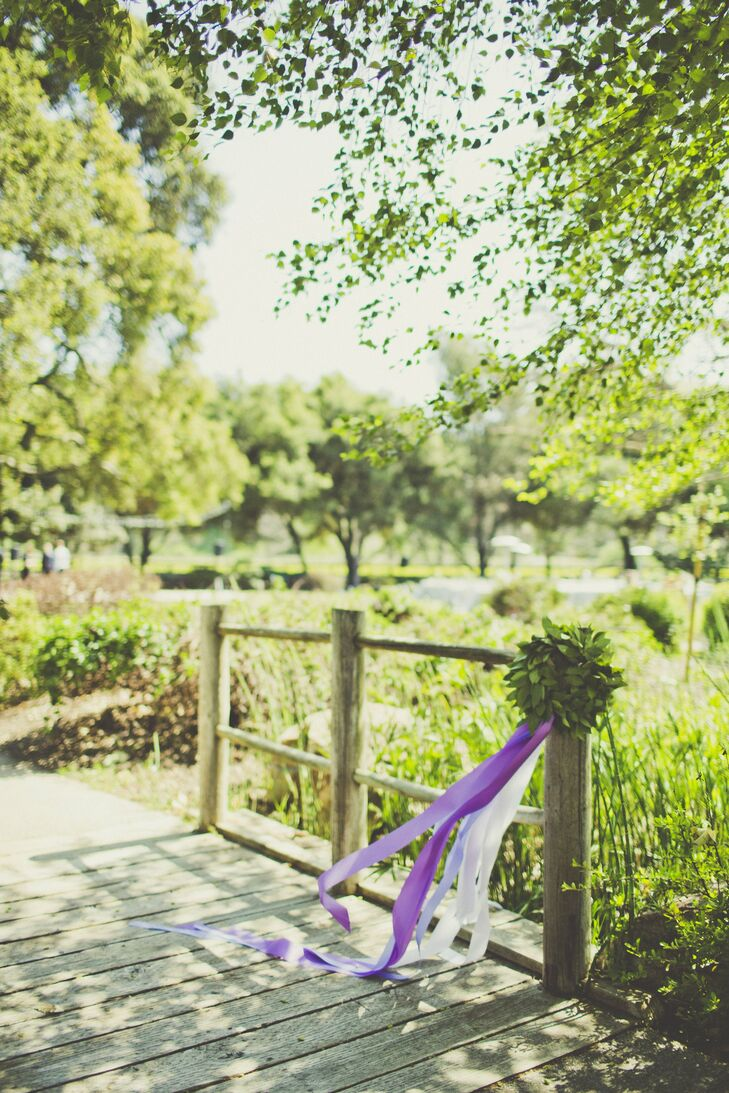 Cascading ribbons were a subtle design motif in the wedding, as they were included in the ceremony decor and several flower arrangements.