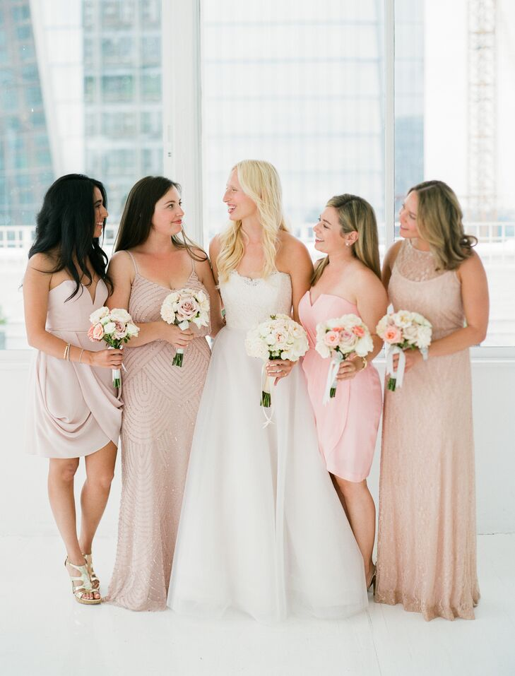 """I knew from the start that I wanted them to wear something fun and flirty—not uptight—and definitely not typical bridesmaid dresses,"" Mia says of her bridesmaid dresses. To avoid a cookie-cutter look, Mia asked each bridesmaid to choose her own blush gown for the event, selecting the most comfortable style. ""So often you hear of bridesmaids complaining about the same boring dresses they all had to wear, and I didn't want my friends to go through,"" she says. ""We had never seen the dresses together until the day of the wedding, and they turned out to be a perfect spectrum of blush."""