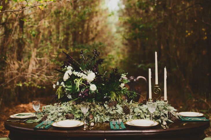 """Since we eloped, we didn't really have a reception,"" Candice says. ""Our celebration ended with an amazing dinner outside in the woods."" Teacup Floral created an asymmetrical centerpiece with black and white flowers, lush greenery and pinecones. ""I loved the candelabra to finish the look,"" she says."