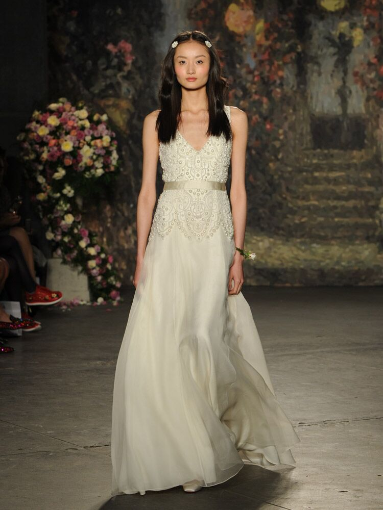 Jenny packham debuts wedding dress collection for bridal fashion week jenny packham wedding dress with intricate scalloped beaded bodice with pearls from spring 2016 junglespirit Choice Image