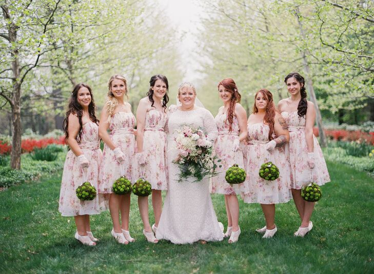 The bridesmaids wore soft pastel dresses, reminiscent of spring, with lace-heeled shoes, lace gloves, and ruby heart-shaped necklaces with matching earrings. They carried