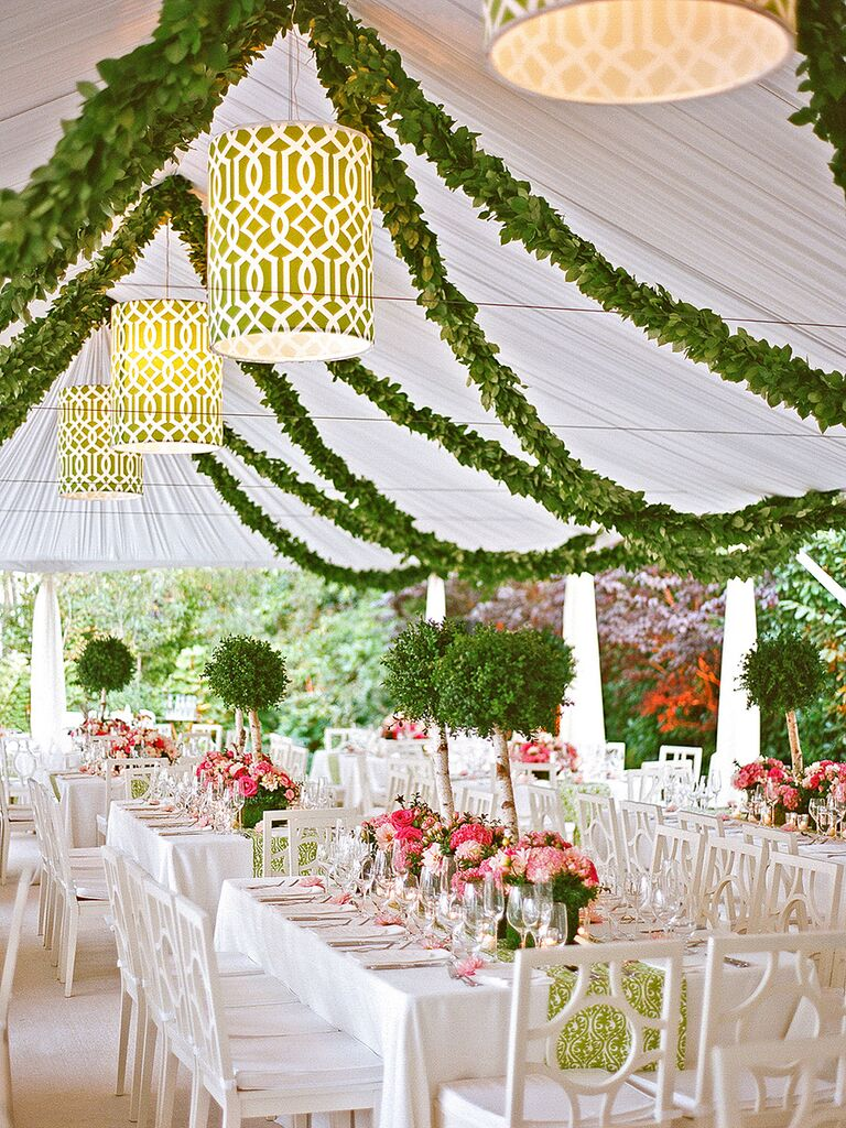 Outdoor Wedding Tent With Mini Tree Centerpieces Lamps And Hanging Garlands