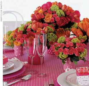 A pink, orange and green polka dot floral place setting