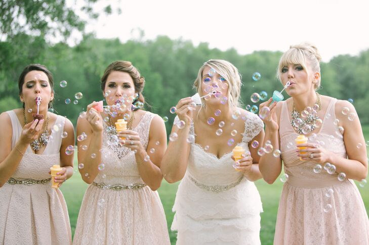 Bridesmaids in Blush Dresses Blowing Bubbles