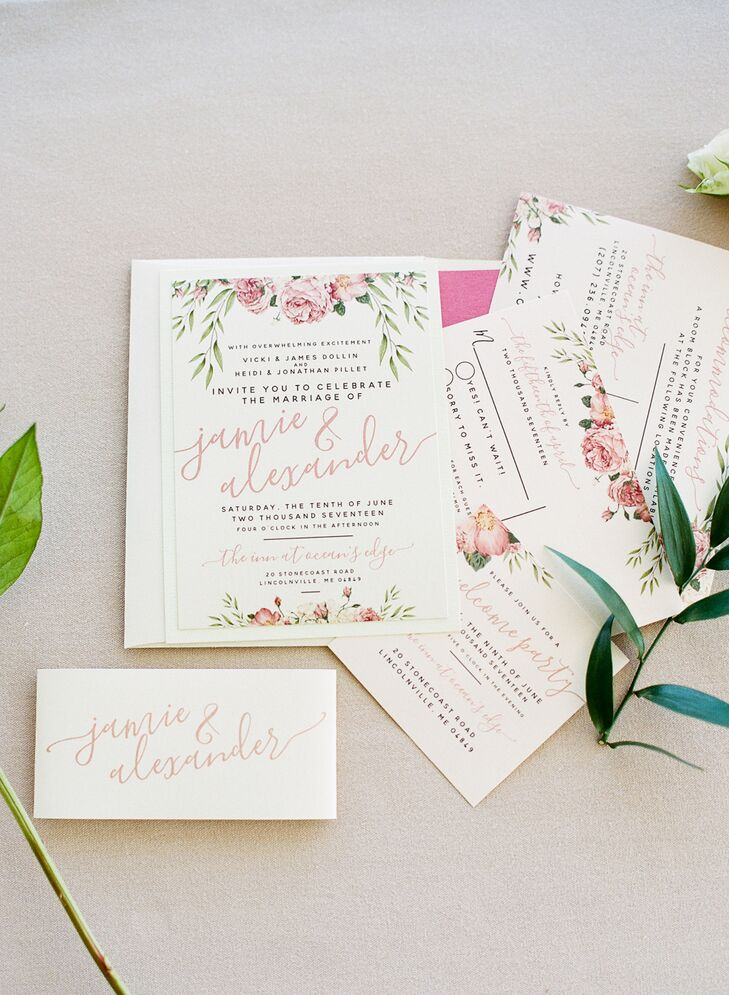 The couple's invitations, escort cards, menu and wedding signs were designed by Red Letter Day Invitations. They matched the pink and peach blooms in the tablescape  bouquets.