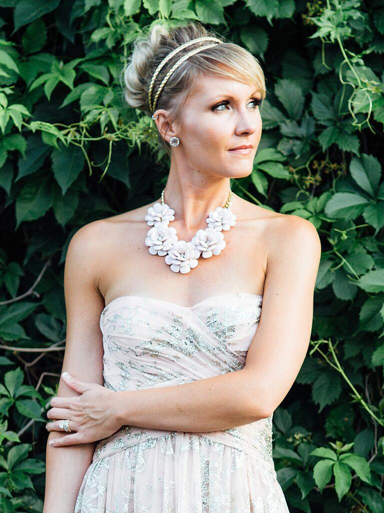 A simple bridesmaid wedding hairstyle for a strapless dress neckline with a metallic headband
