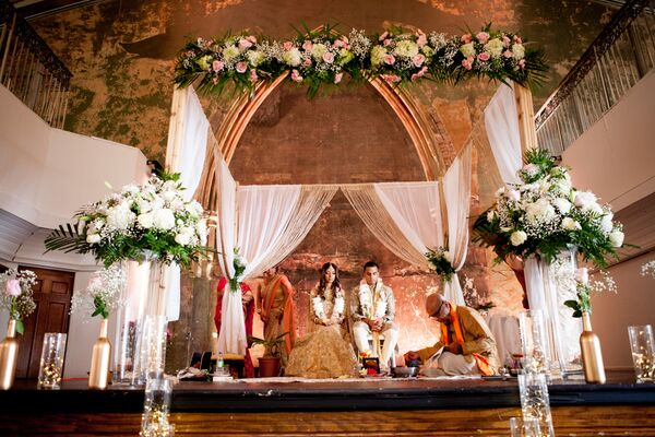 Mandap Draped with White Fabric and Flowers