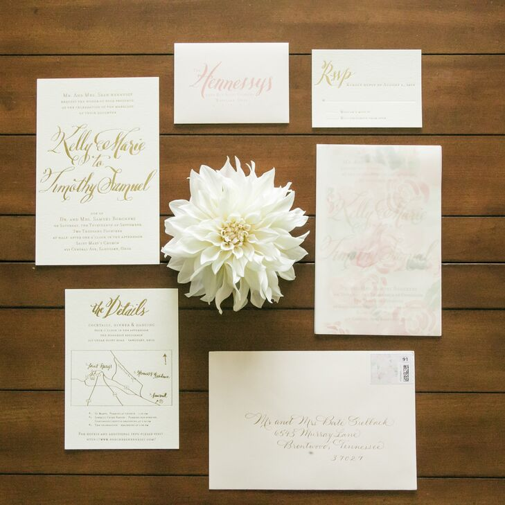 """I wanted something different yet classic, so we did cardstock with gold foil script,"" says Kelly. "" Instead of using the traditional tissue paper, we decided to go with a translucent floral paper insert which Deanna painted herself and made copies of."""