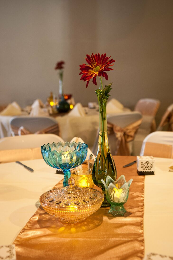 Colorful vintage glass and floral centerpieces