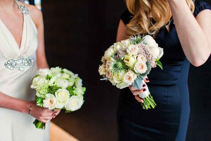 Lauren's bouquet consisted of white and ivory roses, hydrangeas and greens. Her bridesmaid bouquets included ivory, blush and pale yellow roses, thistles and dusty miller.