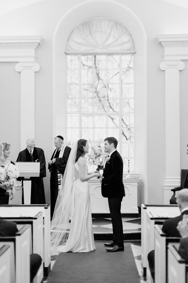 The ceremony took place at All Souls Church in New York City. Lauren and Rich incorporated both Jewish and Christian traditions at their ceremony, which was officiated by both a rabbi and a priest.