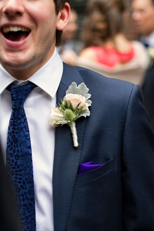 Rich and his groomsmen wore boutonnieres with blush roses, dusty miller and thistles. They also sported purple pocket squares.