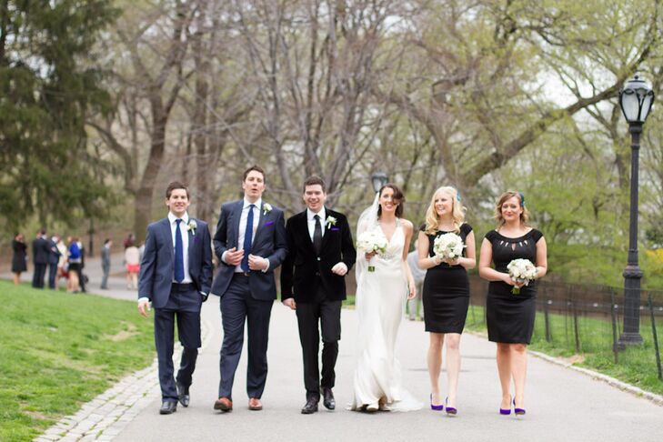 The groomsmen sported navy suits with navy ties while Rich chose a black suit and tie. The bridesmaids donned black Karen Millen dresses with purple shoes that matched the groomsmen's pocket squares.