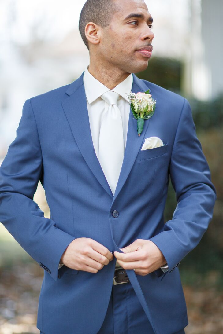 Groom in a Blue Suit, White Tie and Rose Boutonniere