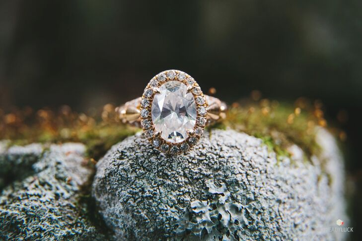 "A local jeweler created custom rings for the couple. ""I had seen so many engagement rings, and I knew I wanted something different,"" Amy says. Geoff had an oval diamond with split shank sides and a mix of rose and yellow gold created for Amy. ""He did a wonderful job,"" Amy says."