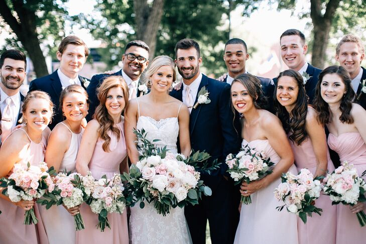 The bridesmaids wore dresses varying in color from champagne to blush, in four styles. Jonny and his groomsmen wore navy tuxes with matching vests, blush ties, suspenders and gold shotgun shells at the base of their boutonnieres.