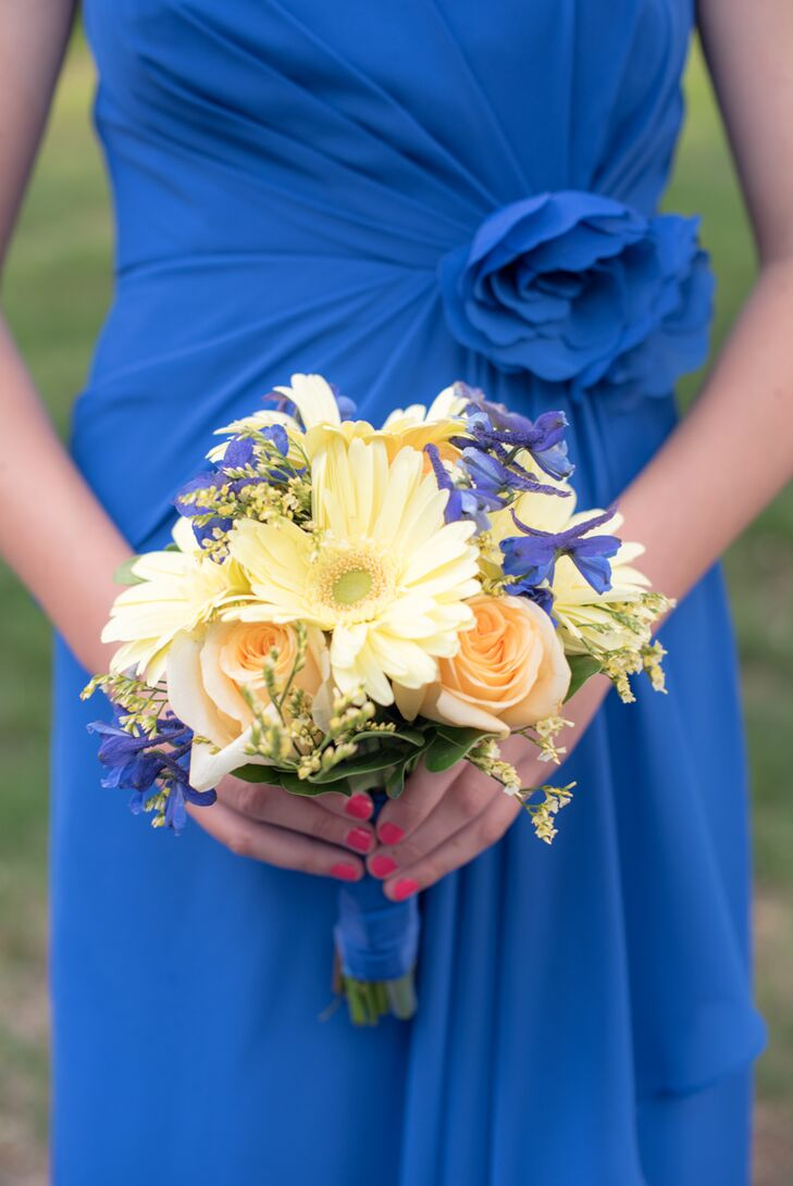 The couple went for an understated, summery aesthetic when it came to the flowers. For the ceremony, Katie and her bridesmaids carried fresh bunches of gerbera daisies, creme de la creme roses, delphiniums and calla lilies down the aisle in soft, cheerful shades of yellow, peach and blue.