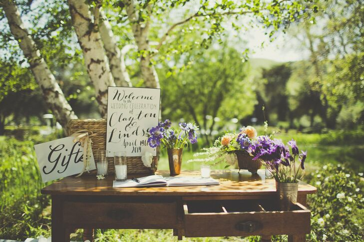 """I wanted clean vintage items mixed with more modern pieces to keep our wedding from looking too rustic,"" Lindsey says of her wedding decor."