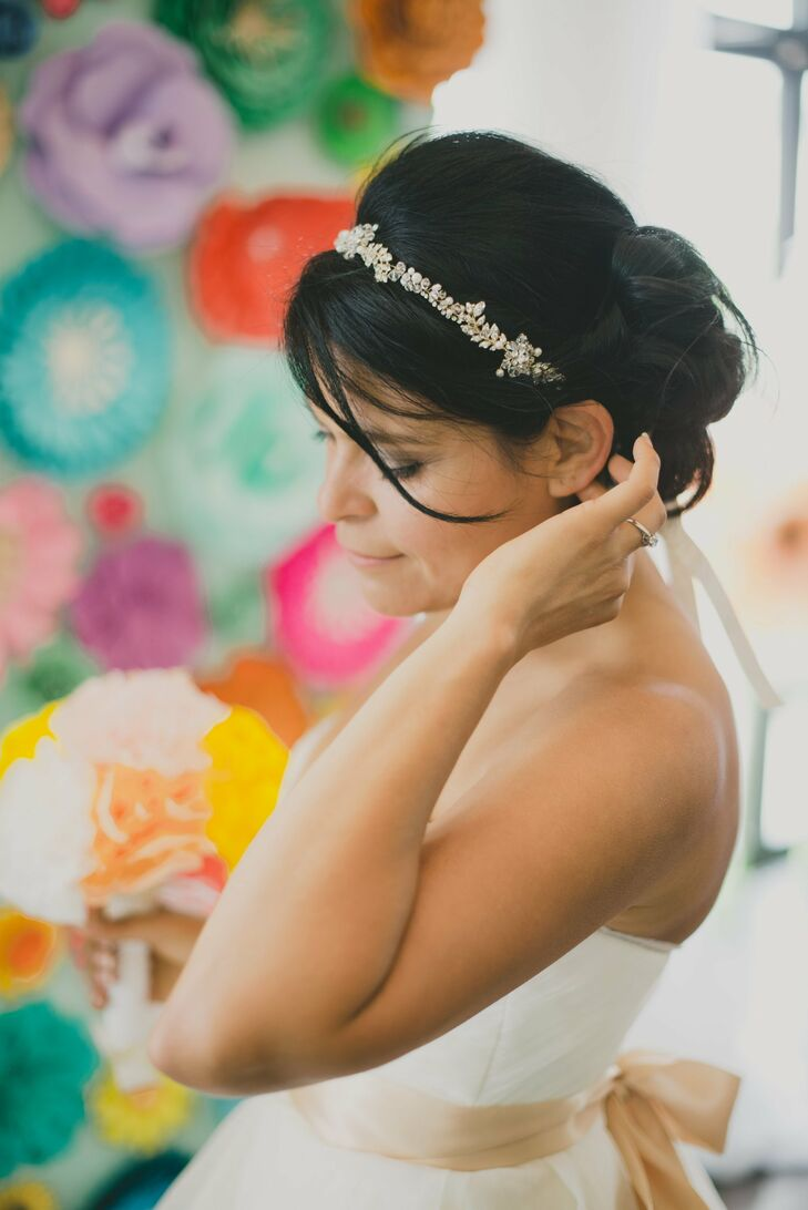 Kristin's jewel leaf headband perfectly complemented her loose updo.