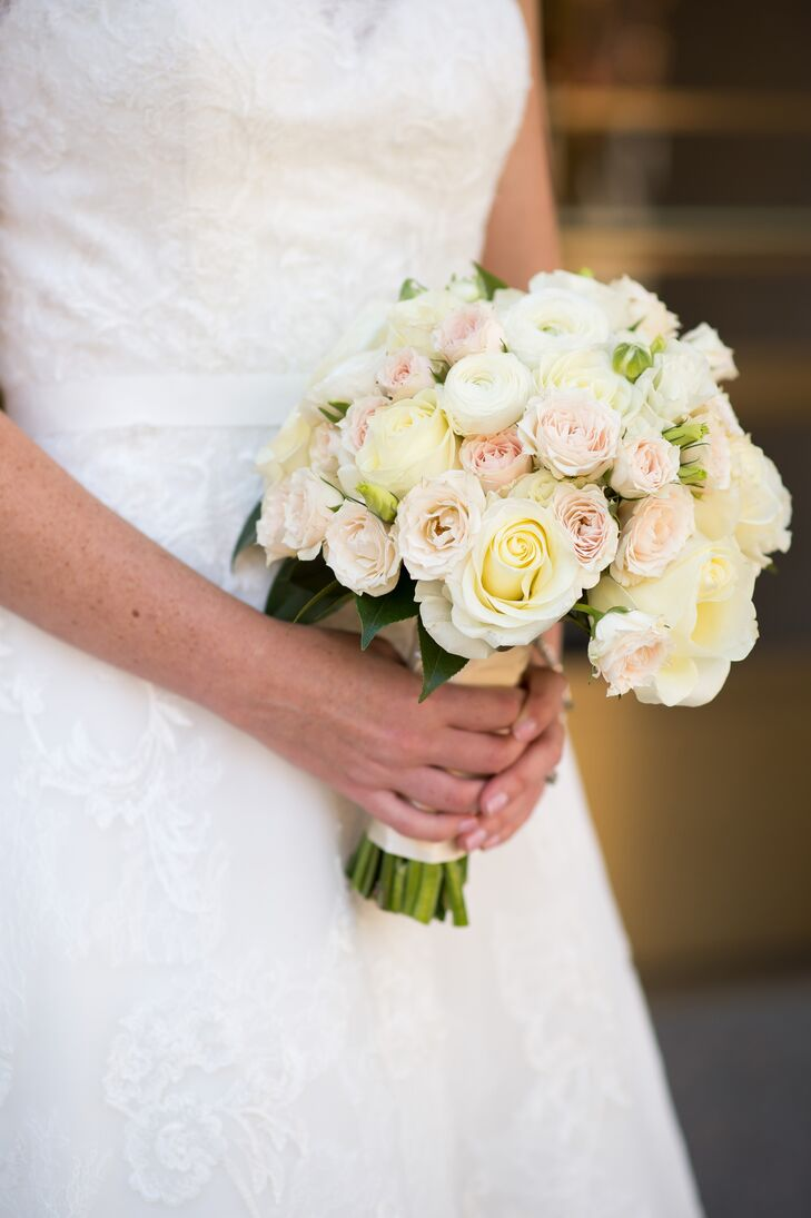 The classic bridal bouquet featured garden roses, miniature spray roses and ranunculus in neutral colors.