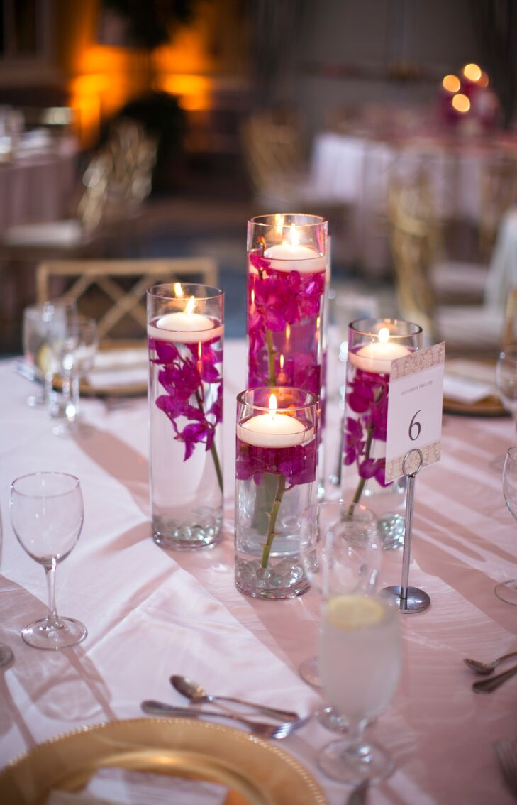 Floating candle and fuchsia delphinium centerpiece