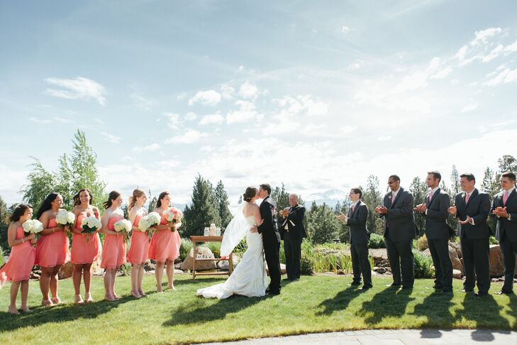 The bridesmaids wore strapless knee-length coral dresses in one of two styles chosen by Kellie. The groomsmen matched the bridesmaid apparel with coral ties, in addition to their charcoal suits.