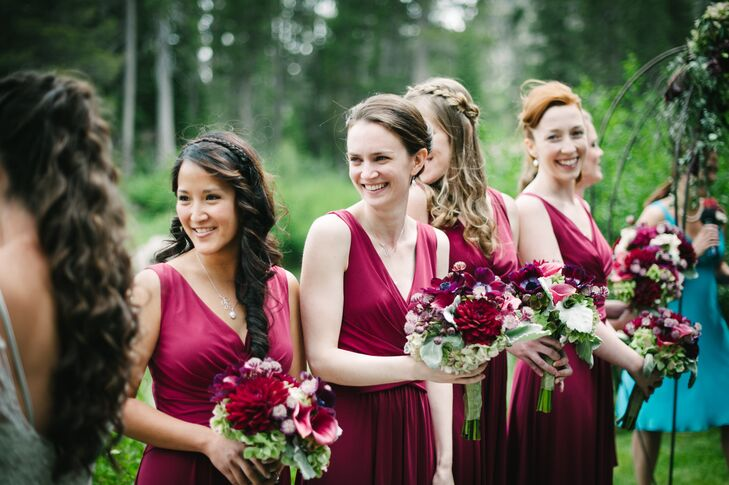 """The bridesmaids wore Ivy & Blu V-neck dresses from Nordstrom,"" the couple says. ""These wonderfully accommodated all the girls, nobody had to get alterations and some have even worn the dress multiple times since. The bride's gift to the bridesmaids was a set of freshwater pearl jewelry: a necklace and earrings."""